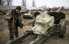 Отвод вооружений в Донбассе. «Донецк находится в серьезной осаде»