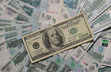 Доллар опускался ниже 60 рублей впервые за 2 месяца