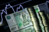 Новый валютный шторм. Рубль падает вслед за нефтью